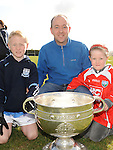 Andy, Jack and Emily Murphy pictured with the Sam Maguire cup at Newtown Blues GAA club. Photo: Colin Bell/pressphotos.ie