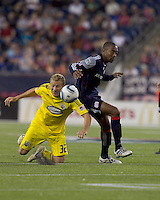 Columbus Crew forward Steven Lenhart (32) goes low for head ball as New England Revolution defender Cory Gibbs (12) defends. The New England Revolution tied Columbus Crew, 2-2, at Gillette Stadium on September 25, 2010.