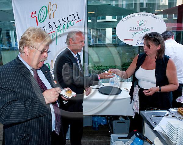 Brussels-Belgium - June 27, 2011 -- ?Westfaelisch Geniessen e.V.? participates at the Summer Party of North Rhine-Westphalia in Brussels; here, MEP Elmar BROK, N.N., Susanne GONSCHOREK -- no model releases -- Photo: Horst Wagner / eup-images