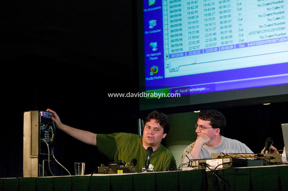 Telecom specialists, Eric Cronin (L) and Micah Sherr, give a talk on how to prevent law enforcement wiretaps during the 6th edition of HOPE, an annual hackers' convention, July 22nd 2006, New York City, USA.
