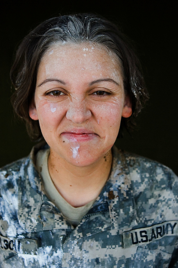 Specialist Sabrina Wilson, 27, Batesville, IN, Medic (doused in shampoo, foot powder, sun tan lotion and other assorted hygiene products by way of initiation following her promotion to the rank of Specialist) Charlie Medical Company 501st Field Support Battalion 1st Brigade 1st Armored Division taken at the company's medical facility at Camp Ramadi, Iraq on Sunday Oct. 01, 2006.<br />
