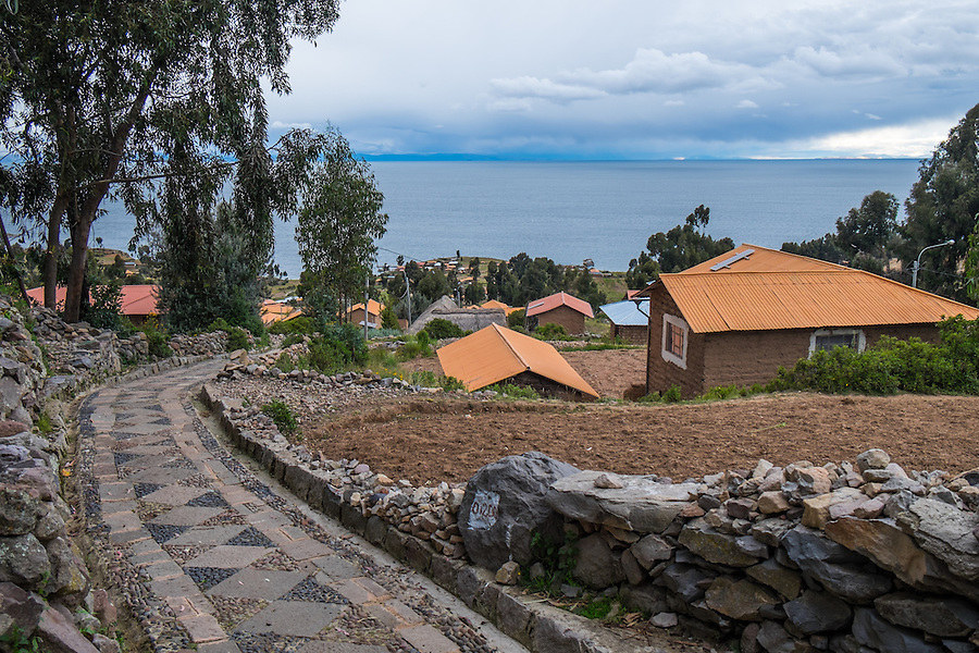 View of houses and path in Amantani Island in Lake Titicaca, Peru.
