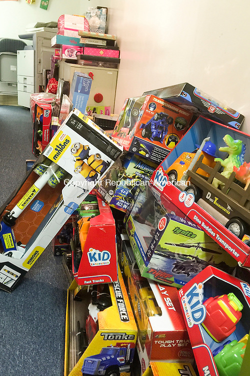 TORRINGTON, CT - 14 December 2015-121415EC02-- Gifts donated during the Christmas for Children Toy Drive, run by the Torrington Firefighters' Association, are organized at the Friendly Hands Food Bank in Torrington Monday. Electronics, bikes, games and gift cards were among the items donated. The annual toy drive ends Tuesday. Erin Covey Republican-American.