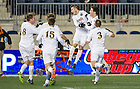 Dec. 13, 2013; Notre Dame midfielder Patrick Hodan (right, jumping) celebrates his goal against New Mexico with teammates in the second half of the College Cup semifinals at PPL Park in Chester, Pa. Notre Dame advances to the finals after defeating New Mexico 2-0. Photo by Barbara Johnston/University of Notre Dame
