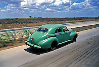 Classic American Vintage Car Speeding along Highway to Cienfuegos Cuba, Republic of Cuba,