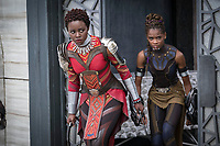 Black Panther (2018)<br /> L to R: Nakia (Lupita Nyong'o) and Shuri (Letitia Wright)<br /> *Filmstill - Editorial Use Only*<br /> CAP/KFS<br /> Image supplied by Capital Pictures