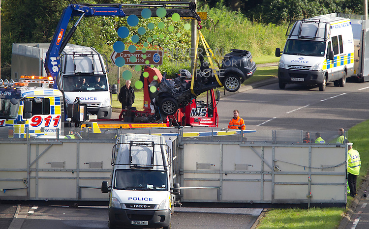 Cars being taken away from the accident after three men have died and another man has been injured in a car crash in Cumbernauld, North Lanarkshire..Three men died at the scene and the injured man has been taken to Monklands Hospital in Airdrie. Police said his condition was not known..The dual carraigeway is currently closed in both directions..Strathclyde Police said it was trying to establish the cause of the crash and the road would remain closed for some time..Picture: Maurice McDonald/Universal News And Sport (Europe). 1 August  2012. www.unpixs.com.
