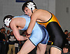 Mike D'Angelo of Commack, top, battles James Matias of Rocky Point at 138 pounds during the Suffolk County varsity wrestling Division I semifinals at Hofstra University on Sunday, February 15, 2015. D'Angelo won the match by major decision.<br /> <br /> James Escher