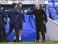 7th July 2020; Madejski Stadium, Reading, Berkshire, England; English Championship Football, Reading versus Huddersfield; Danny Cowley Manager of Huddersfield and Mark Bowen Manager of Reading bump hands at the end of the match 0-0