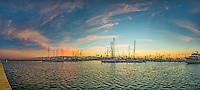 Corpus Christi Marina Pano - is panorama of the marina in Corpus Christi at sunrise with the colorful sky in the background and the sea wall running along for a good distance.