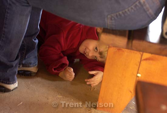 Nathaniel Nelson, hiding from me, at CCNS pre-school field trip to Wheeler Farm. 11/16/2001, 10:25:31 AM<br />