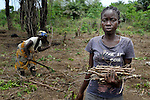 "Alice Sampea, 32, works with several dozen women to grow cassava on a six-acre farm in Mount Barclay, Liberia. The income-generating project, called ""Say No to Poverty,"" is administered by the National Federation of Women Employees and Allied Workers, with financial support from United Methodist Women. Behind her is Martha Francis, 53."