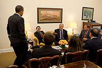 Washington, DC - October 6, 2009 -- United States President Obama drops by Gen. James Jones's meeting with Iraqi President Jalal Talabani in the National Security Advisor's  West Wing office at the White House, Tuesday, October 6, 2009.<br /> CAP/MPI/CNP/RS<br /> &copy;RS/CNP/MPI/Capital Pictures