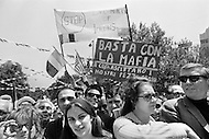 29 Jun 1970, Manhattan, New York City, New York State, USA. A crowd of 75,000 Italian Americans gathers at New York's Columbus Circle for Italian Unity Day. The demonstrators hold signs protesting the Mafia and discrimination against people of Italian descent.