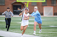 College Park, MD - February 24, 2019: North Carolina Tar Heels Tayler Warehime (22) tries to push Maryland Terrapins defender Lizzie Colson (25) out of bounds during the game between North Carolina and Maryland at  Capital One Field at Maryland Stadium in College Park, MD.  (Photo by Elliott Brown/Media Images International)