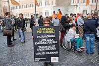 Roma 5 Novembre 2014<br /> Manifestazione davanti al Parlamento, dell'associazione, &quot;Tutti a scuola&quot;, per protestare contro  legge di stabilit&agrave; del Governo Renzi, che taglia i  fondo nazionale della non autosufficienza e   cancella i diritti dei disabili. I manifestanti  portano una ghigliottina per decapitare simbolicamente i politici. <br /> Rome November 5, 2014 <br /> Demonstration in front of the Parliament of the association &quot;Everybody to School&quot; to protest against the law of stability of the  Prime Minister Renzi's government, which cuts the bottom of national self-sufficiency and cancels out the rights of the disabled. Protesters carry a guillotine to decapitate symbolically politicians.