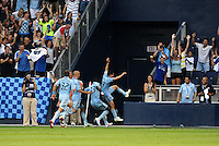 Sporting KC palyers celebrate Omar Bravo's stoppage time equalizer... Sporting KC and Chivas USA played to a 1-1 tie at LIVESTRONG Sporting Park, Kansas City, Kansas.