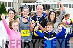 Runners Louise Devaney and Eddie O'Sullivan are welcomed home by Sorcha and Eilish Blackwell, Finás Blackwell, Brayden and Maria slattery  at the finish of the Killarney Run half marathon in the Gleneagle Hotel on Saturday