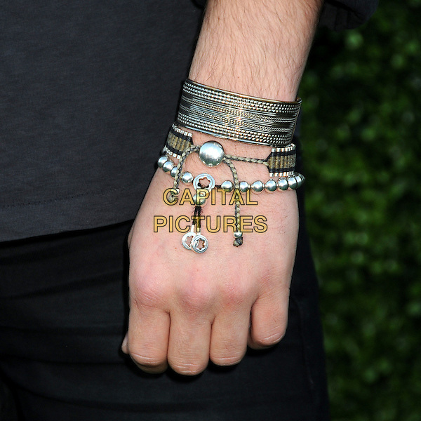 ED WESTWICK's bracelet.CBS Summer Press Tour Party 2010 held at The Tent, Beverly Hills, California, USA..July 28th, 2010.hand silver charm beads cuff jewellery jewelry .CAP/ADM/BP.©Byron Purvis/AdMedia/Capital Pictures.
