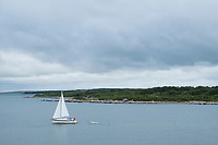 A sailboat is seen off the coast of Martha's Vineyard, Massachusetts, USA.