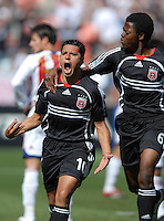 DC United midfielder Christian Gomez (10) celebrates with teammate Kasali Yinka Casal after scoring the first goal of the game in the 48th minute. DC United defeated Chivas USA 2-1, at RFK Stadium in Washington DC, Sunday May 6, 2007.