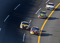 Apr 28, 2007; Talladega, AL, USA; Nascar Busch Series driver Bobby Labonte (77) passes Tony Stewart (33) in the tri-oval for the win during the Aarons 312 at Talladega Superspeedway. Mandatory Credit: Mark J. Rebilas