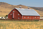 Red barn with cupola in central Oregon.