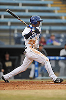 Asheville Tourists left fielder Raimel Tapia #15 swings at a pitch during game one of a double header against the West Virginia Power at McCormick Field on April 8, 2014 in Asheville, North Carolina. The Power defeated the Tourists 6-5. (Tony Farlow/Four Seam Images)