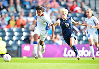 July 25, 2012..Megan Rapinoe (15), and Wendie Renard (2). USA vs France Football match during 2012 Olympic Games at Hampden Park in Glasgow, England. USA defeat France 4-2 after conceding two goals in the first half of the match...(Credit Image: © Mo Khursheed/TFV Media)