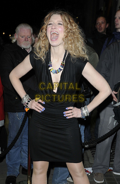 "Melanie Masson.The ""Macbeth"" press night performance, Trafalgar Studios, Whitehall, London, England..February 22nd, 2013.half length black cowl neck sleeveless dress smiling hands arms mouth open necklace bracelets silver funny .CAP/CAN.©Can Nguyen/Capital Pictures."