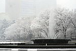 Snow falls at Hibiya Park in Tokyo, Japan on January 22, 2018. Japanese media predicted that heavy snow will hit Tokyo on the afternoon and night of January 22nd and expect it to settle affecting transport as workers head home in the evening and try to get to work on the 23rd. (Photo by Naoki Nishimura/AFLO)