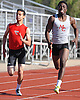 Matt Ferrer of Connetquot, left, and Denzel Williams of Middle Country finish in first and second respectively in the 200 meter race during a Suffolk County boys' track and field meet at Connetquot High School on Thursday, May 14, 2015. Ferrer's winning time was 22.2 seconds.<br /> <br /> James Escher