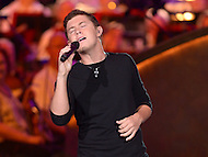 "July 3, 2013  (Washington, DC)  Former American Idol contestant and country music entertainer Scott ""Scotty"" McCreery performs at the 2013 ""A Capitol Fourth"" concert rehearsal at the U.S. Capitol on July 3, 2013.  (Photo by Don Baxter/Media Images International)"