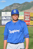 Lenix Osuna (13) of the Ogden Raptors poses for a photo during media day on June 14, 2014 at Lindquist Field in Ogden, Utah. (Stephen Smith/Four Seam Images)