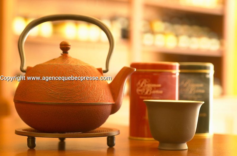 July 2002, Montreal, Quebec, Canada<br /> <br /> A traditional Chinse Tea Pot and cup,<br />  in a Montreal Tea store.<br /> <br /> <br /> Licensed for use in the Montreal Guide ONLY<br />  <br /> Mandatory Credit: Photo by Pierre Roussel- Images Distribution. (&copy;) Copyright 2002 by Pierre Roussel <br /> <br /> NOTE  Nikon D-1 jpeg opened with Qimage icc profile, saved in Adobe 1998 RGB.