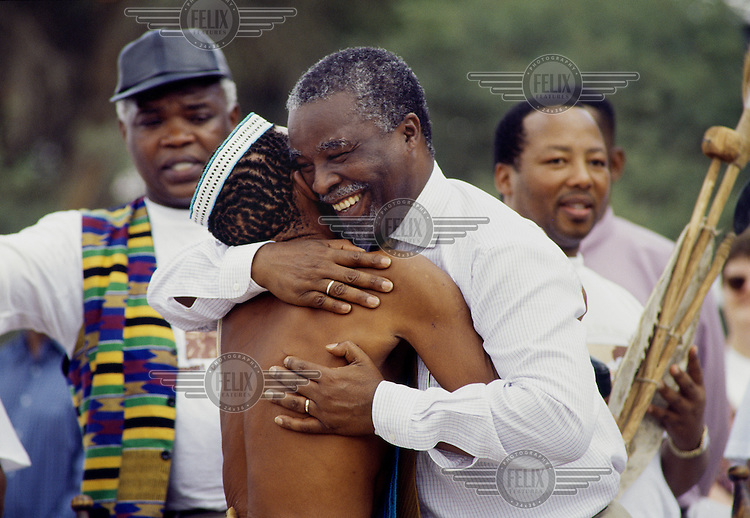 Thabo Mbeki embraces San Bushman Dawid Kruiper during celebrations for the !Khomani land return outside the Kalahari Gemsbok Park (Kgalagadi Transfrontier Park).