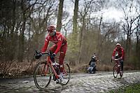 Alexander Kristoff (NOR/Katusha) over the infamous cobbles of sector 18: Trou&eacute;e d'Arenberg (Bois de Wallers)<br /> <br /> recon of the 114th Paris - Roubaix