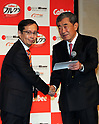 """May 25, 2017, Tokyo, Japan - Chinese online commerce giant Alibaba CEO Daniel Zhang (L) shakes hands with Japanese food maker Calbee chairman Akira Matsumoto as they announce Calbee will sell their popular breakfast cereal """"Frugra"""" to Chinese market through Alibaba's cross-border e-commerce website """"Tmall Global"""" in Tokyo on Thursday, May 25, 2017. Calbee aims at to sell Frugra 100 billion yen in overseas market.   (Photo by Yoshio Tsunoda/AFLO) LwX -ytd-"""