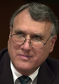 United States Senator John Kyl (Republican of Arizona) listens as Robert S. Mueller, III testifies before the United States Senate Committee on the Judiciary to be confirmed as the Director of the Federal Bureau of Investigation (FBI) on Capitol Hill in Washington, DC on July 30, 2001. If confirmed, Mueller will succeed Louis J. Freeh.<br /> Credit: Ron Sachs / CNP