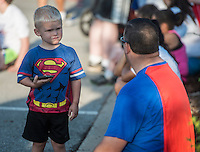 NWA Democrat-Gazette/ANTHONY REYES • @NWATONYR<br /> Jared Dalmut hangs out with his son Mason Dalmut, 3, both of Rogers, Monday, Sept. 7, 2015 at the 12th Annual Run for a Child's Hunger race at the Promenade in Rogers. The pair ran in the one mile fun run. The race has teamed up with Care Community Center to help fight hunger in the region. The event featured multiple activities including a 10K race, 5K race, fun run, inflatable playground for children and a free breakfast.