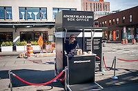 A kiosk for the Lincoln Motor Company promotes their sponsorship of the Tribeca Film Festival in the Meatpacking District in New York on Tuesday, April 12, 2016. (© Richard B. Levine)