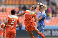 Houston, TX - Saturday April 15, 2017: Sarah Hagen and Julie Ertz go up for a header during a regular season National Women's Soccer League (NWSL) match between the Houston Dash and the Chicago Red Stars at BBVA Compass Stadium.