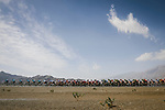 The peloton lined out during Stage 5 of the 10th Tour of Oman 2019, running 152km from Samayil to Jabal Al Akhdhar (Green Mountain), Oman. 20th February 2019.<br /> Picture: ASO/P. Ballet | Cyclefile<br /> All photos usage must carry mandatory copyright credit (&copy; Cyclefile | ASO/P. Ballet)