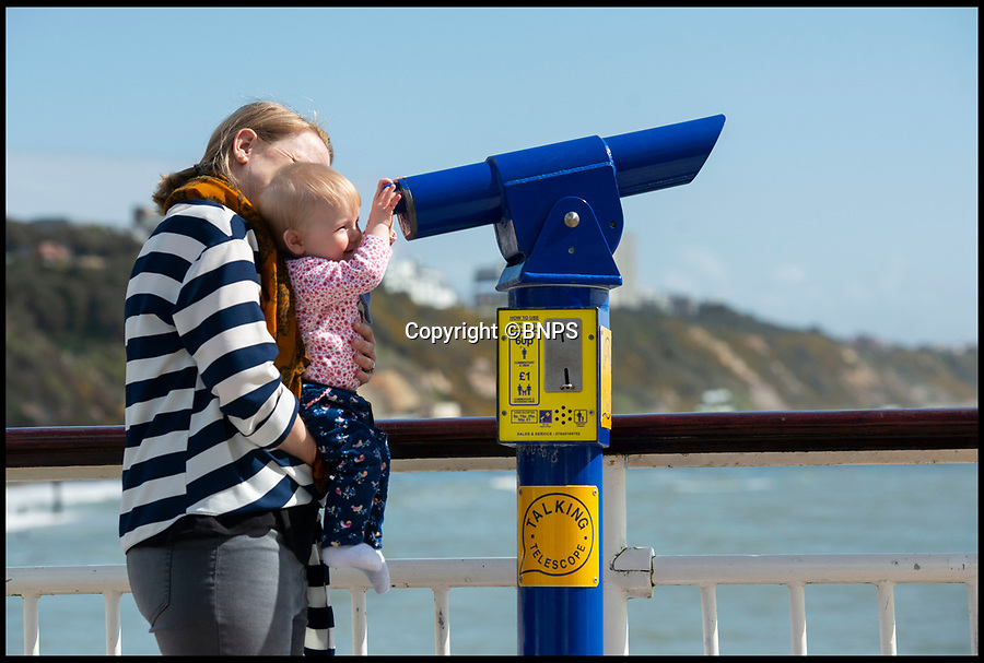 BNPS.co.uk (01202 558833)<br /> Pic: PhilYeomans/BNPS<br /> <br /> Amelie Gregory (9 mths) gets her first view of the sunshine on Bournemouth pier today.<br /> <br /> Spring has finally arrived on Bournemouth beach today...and it looks like it could be here to stay.