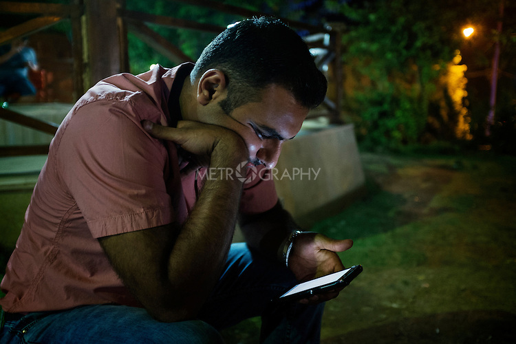 29/08/15. Shaqlawa, Iraq. -- Ahmed (not his real name), 28 y.o. escaped from Falluja in January 2014, when ISIS entered the city and the Iraqi army started shelling the city indiscriminately. He works with other IDPs in Erbil as orientation worker with an international NGO. Ahmed is married and has one daughter, but he has not seen them for the past two years. His father in law one day took them away from him, and he has not been able to track them down ever since. He only has one photo of them on his phone.
