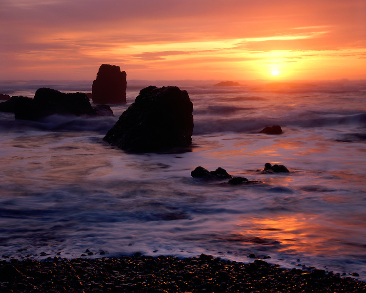 Sunset light on sea stacks in the Pacific Ocean at Crescent Beach (Cannon Beach); Ecola State Park, OR