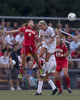 Boston University midfielder Brittany Heist (4) and Boston College forward/midfielder Kate McCarthy (21) battle for head ball. After 2 complete overtime periods, Boston College tied Boston University, 1-1, after 2 overtime periods at Newton Soccer Field, August 19, 2011.