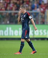 Fussball  1. Bundesliga  Saison 2013/2014  4. Spieltag SC Freiburg - FC Bayern Muenchen        27.08.2013 Bastian Schweinsteiger (FC Bayern Muenchen) muss verletzt ausgewechselt werden