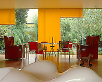 In the foreground of the living/dining area is a famous Ab Rogers Monster Chair