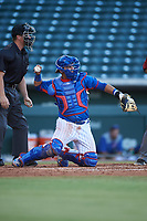 AZL Cubs 2 catcher Orian Nunez (18) throws to the pitcher in front of umpire Jarrod Moehlmann during an Arizona League game against the AZL Dbacks on June 25, 2019 at Sloan Park in Mesa, Arizona. AZL Cubs 2 defeated the AZL Dbacks 4-0. (Zachary Lucy/Four Seam Images)
